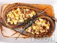 Печена риба зарган с картофи и гъби печурки на фурна